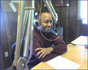 Gregory Anderson speaking at radio station
